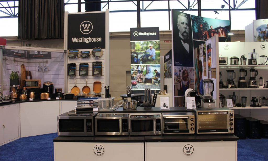 International Home + Housewares Show 2019 - Booth Front View - featuring microwaves and cookware products.