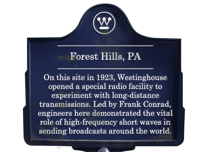 Historical sign from Forest Hills, PA. On this site in 1923, Westinghouse opened a special radio facility to experiment with long-distance transmissions. Led by Frank Conrad, engineers here demonstrated the vital role of high-frequency short waves in sending broadcasts around the world.