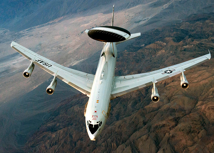 Photo of airplane with airborne surveillance radar system.