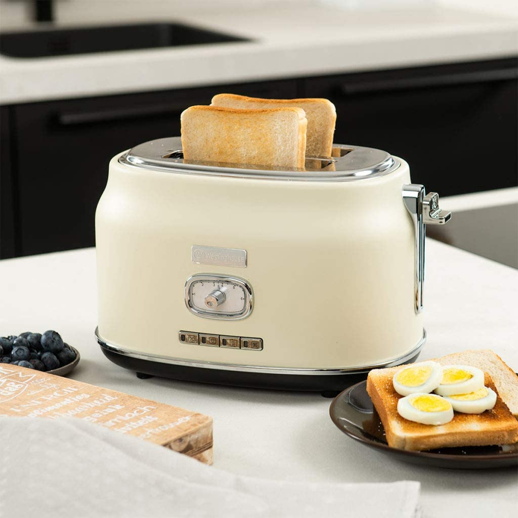 Westinghouse retro styled 2-slice white toaster set on top of a kitchen counter.