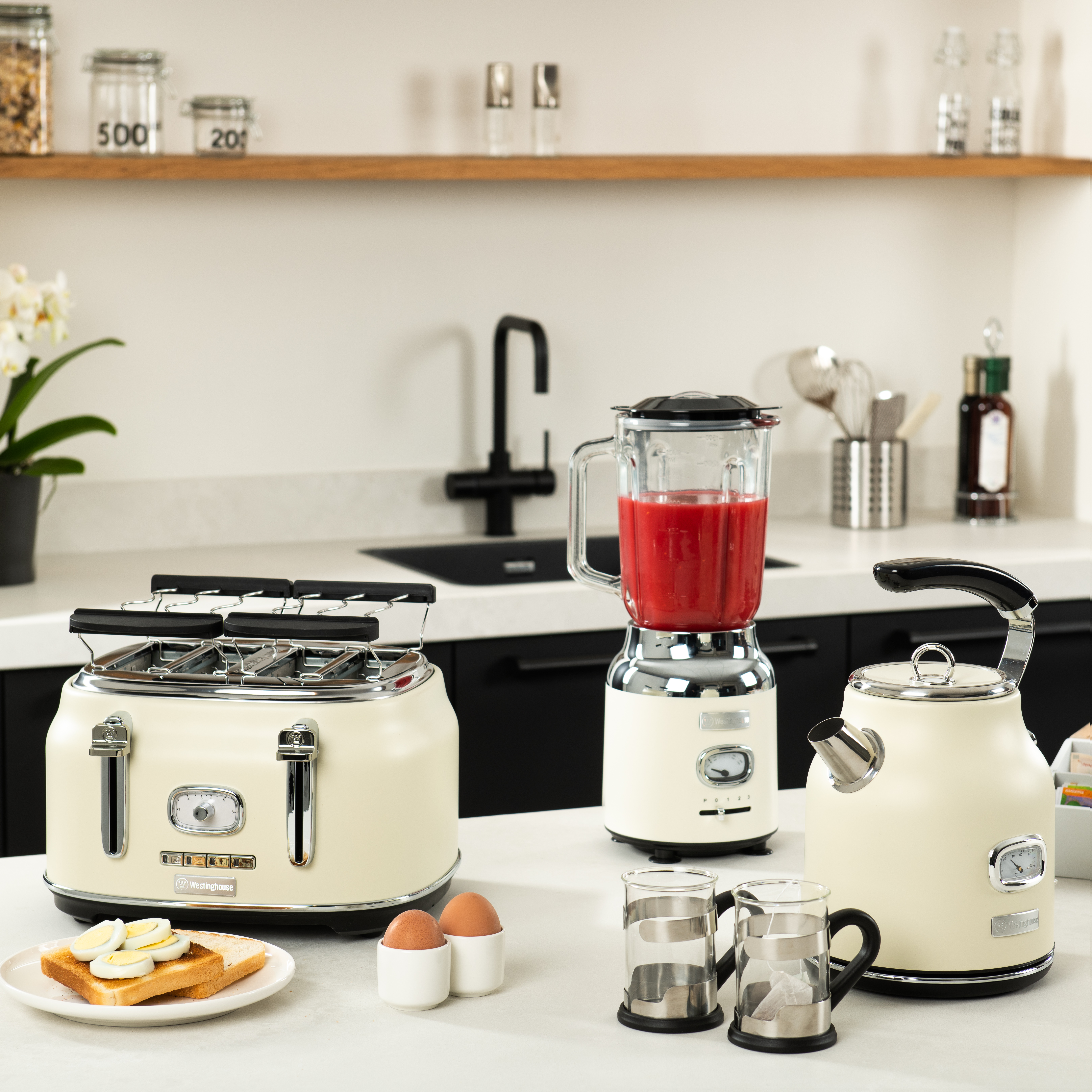 Westinghouse Homeware retro styled small kitchen appliances including a white kettle, blender and toaster set on a counter top.